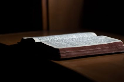 An open Bible on a table