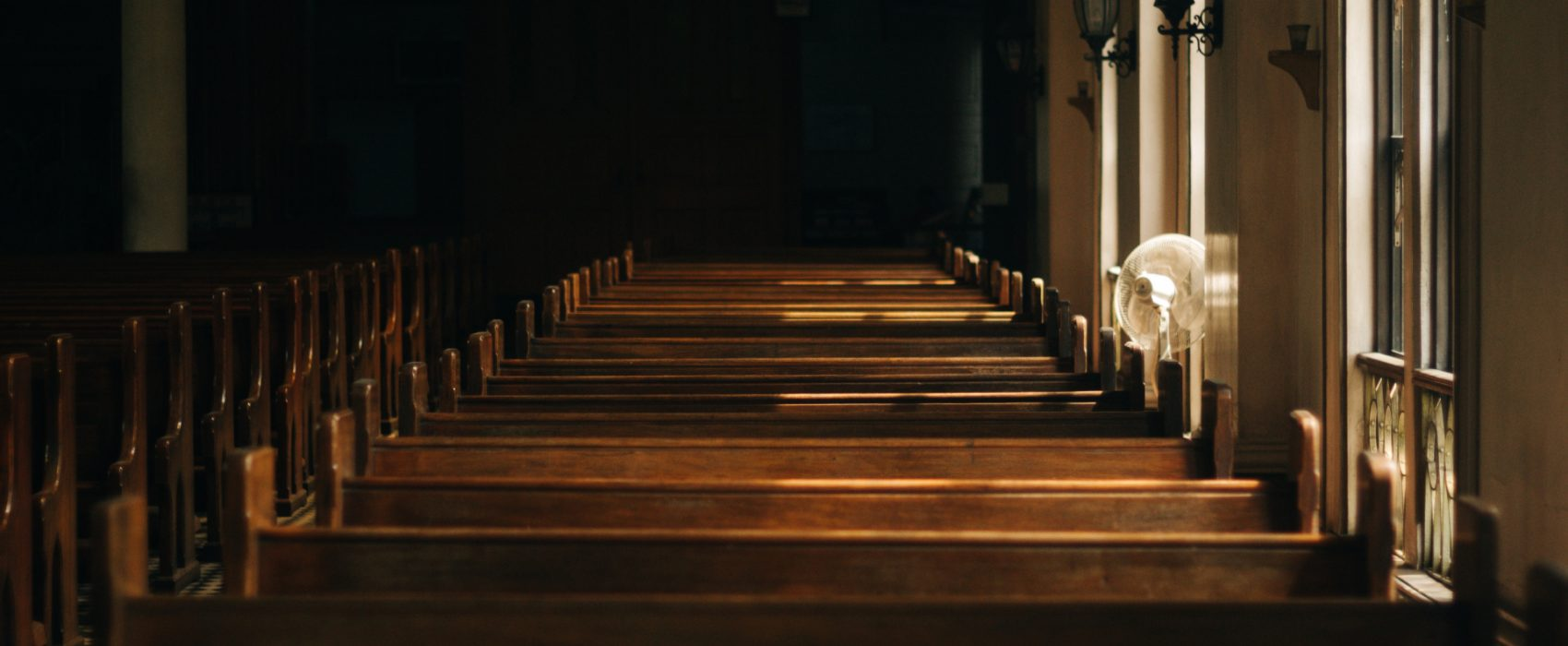 A row of empty pews in a church building